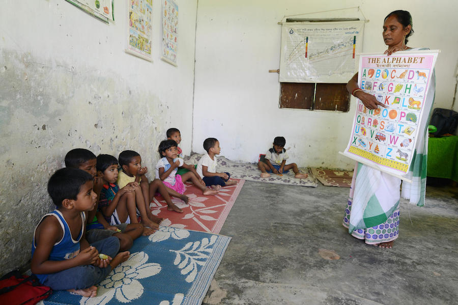 An Anganwadi worker teaching at a UNICEF-supported Anganwadi school at Kharjan Tea Estate in Dibrughar, Assam on June 29, 2019.