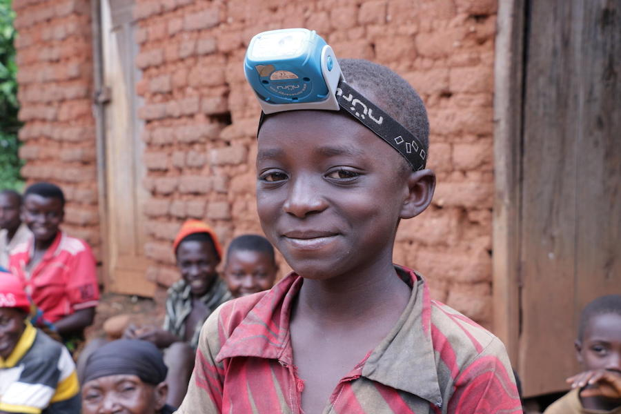 In May 2019, 9-year-old Nadia wears the solar lamp her family bought through Project Lumière, a UNICEF-supported venture that brings solar power to Burundi.