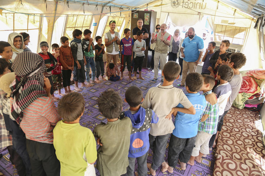 On a visit to Al-Hol camp in northeast Syria in July 2019, UNICEF Syria Representative Fran Esquiza led a cooperative game for a group of displaced children.
