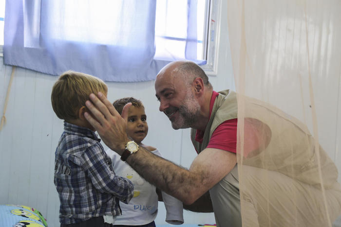 UNICEF Syria Representative Fran Equiza interacting with children at a UNICEF-supported interim care center in Al-Hol camp, northeast Syria, July 2019.