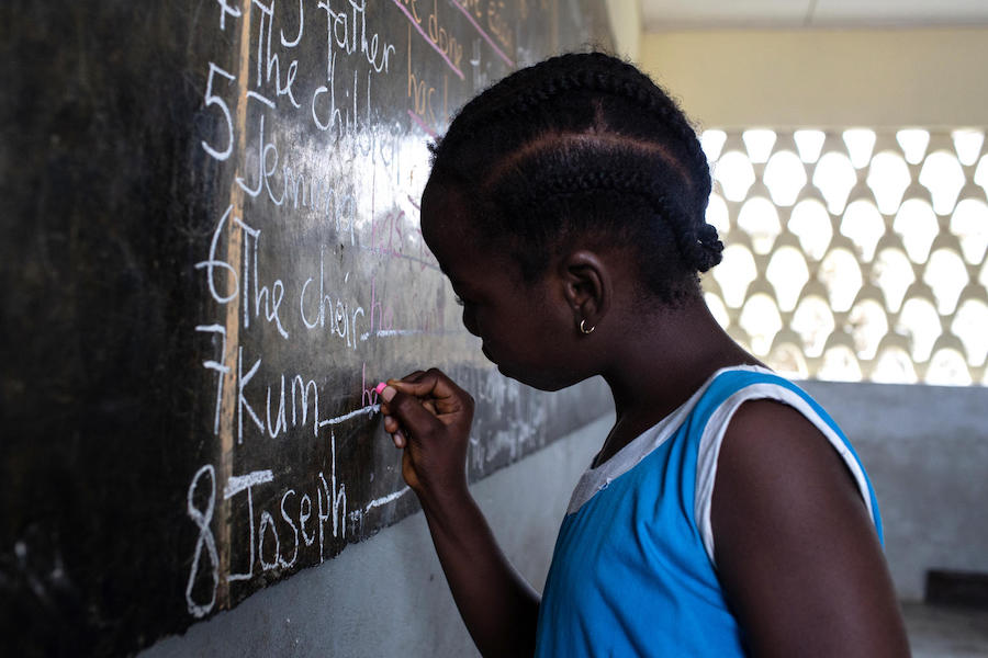 A student works on her spelling at the blackboard in class at GEPS Youpwe, a UNICEF-supported government primary school in Douala, Cameroon on May 21, 2019.