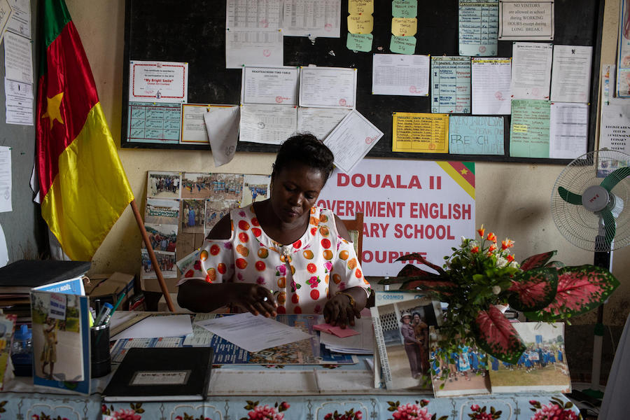 Ms. Delphine Bikajuri, Principal of GEPS Youpwe, a UNICEF-supported government primary school, at her desk in her office in Douala, Cameroon on 21 May 2019.