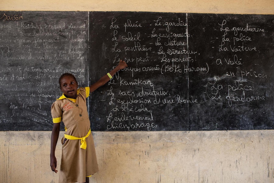 A student goes over blackboard notes for a class in emergency preparedness at a school in Baigaï, a village near the Nigerian border, Far North Region, Cameroon on 26 May 2019.