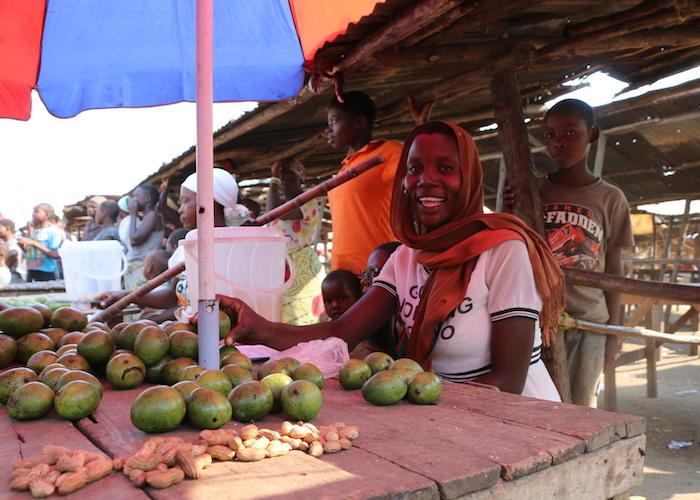 Estelle Nikoyagize, 23, sells mangoes in the market in Gatumba, Burundi. A UNICEF-supported Ebola awareness campaign is helping the community prevent the spread of the disease.