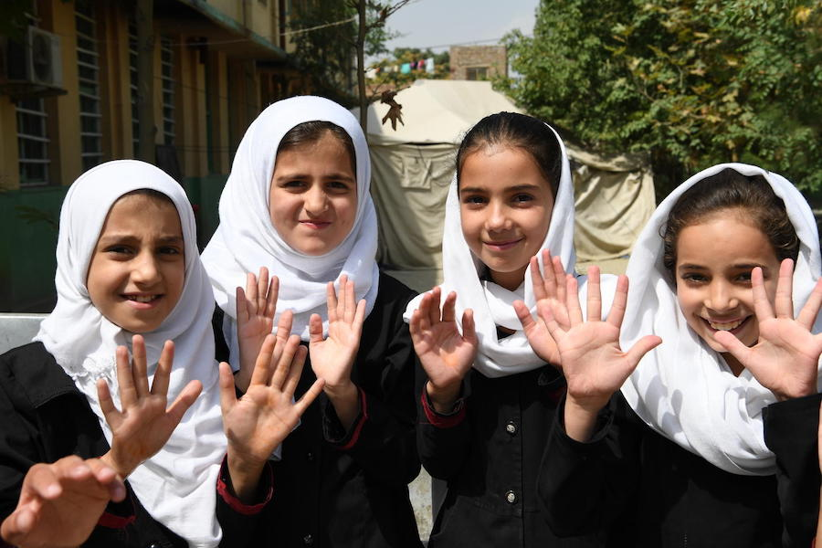 Children have just washed their hands at UNICEF-supported BiBi Mehro Girls High School, in Kabul, the capital of Afghanistan.