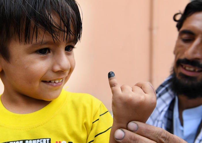 A child's finger is marked after he is vaccinated against polio. UNICEF-supported vaccinators went door-to-door in his neighborhood of Kart-e-Naw, a suburb of Kabul, Afghanistan.
