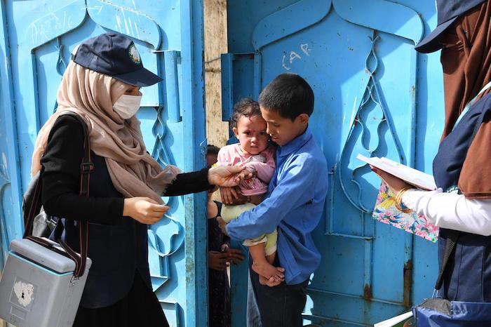 Polio vaccinators go door to door in Kart-e-Naw, a suburb of Kabul, Afghanistan.