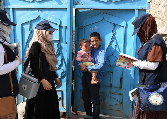 UNICEF-supported polio vaccinators go door-to-door in Kart-e-Naw a suburb of Kabul, the capital of Afghanistan, on August 26, 2019.