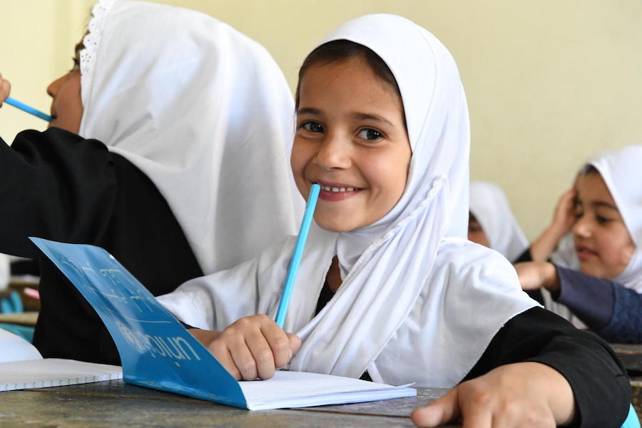 Students at the Bibi Amina Girls High School in Pamjshir, a province in northern Afghanistan, are excited to receive their new UNICEF school kits in August 2019.