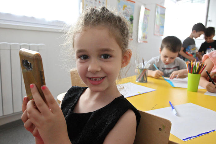 Kids are never too young to learn about online safety. Vasilisa, 6, lives in Serbia, and she and her mother took part in UNICEF-supported workshops held at her preschool to teach the entire family how to stay safe on the internet. © UNICEF/UN0341446/Vas