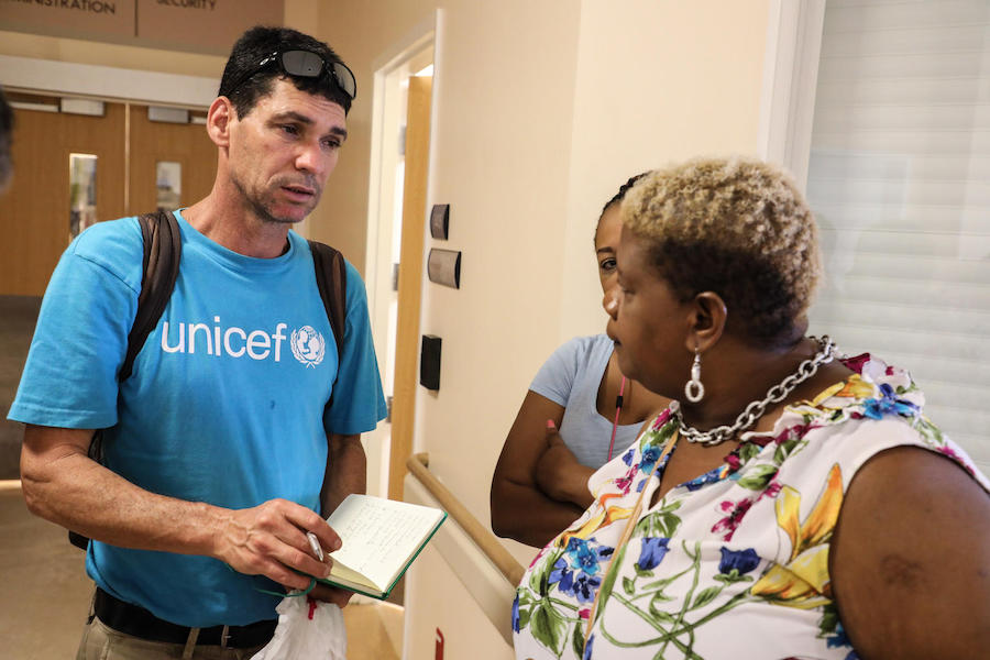 On September 7, 2019, UNICEF Regional Emergency Specialist Hanoch Barlevi talks to a nurse in one of the main hospitals of Marsh Harbour Town.
