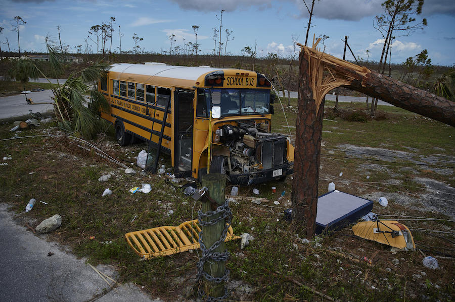 On September 8, 2019 in the Bahamas, a damaged school bus outside St. Francis Church in Marsh Harbour in Abaco Island.