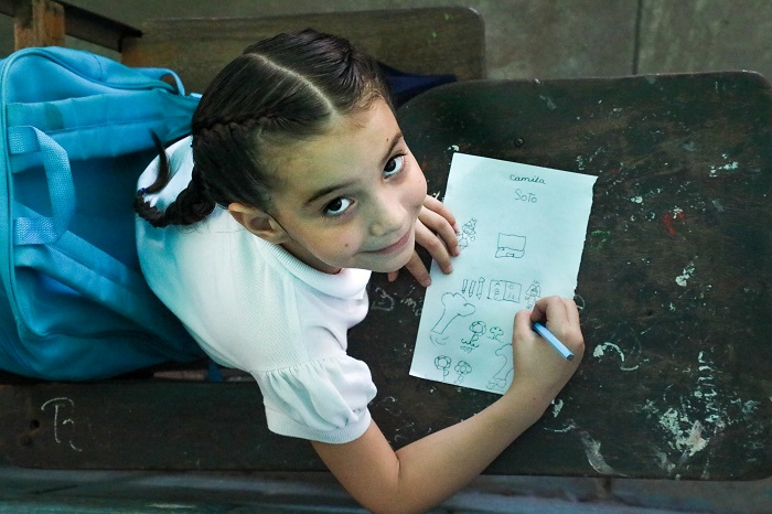 Camila, 6-year-old, draws in her classroom, after receive UNICEF's school kit, Maracaibo, September 2019.