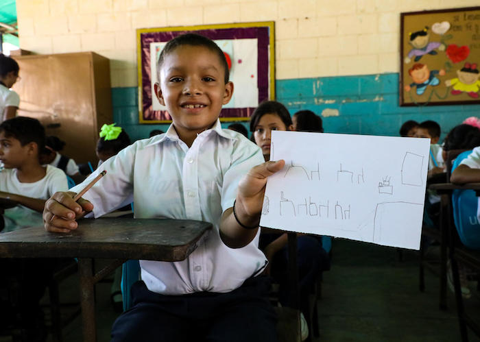 At Fe y Alegría school in Maracaibo, Venezuela in September 2019, Manuel, 8, drew a picture of his ideal classroom. UNICEF distributed backpacks full of school supplies on the first day of school.