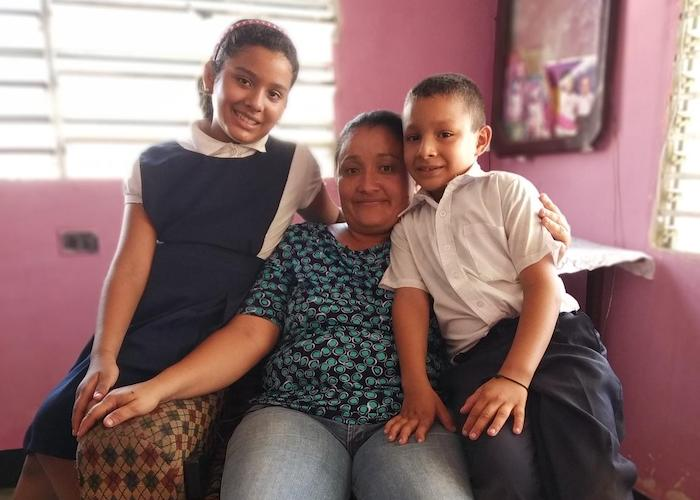 Teacher Laura Albarrán at home with her children, ten-year-old Valeria and 8-year-old Manuel, in Maracaibo, Venezuela in September 2019.