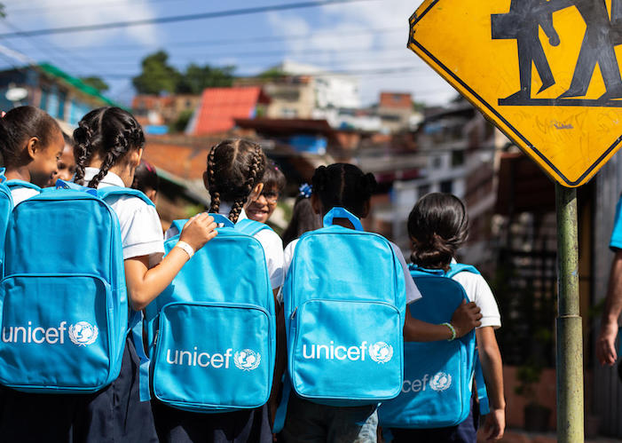 Students at the Municipal School Jermán Ubaldo Lira in Baruta, Venezuela received UNICEF backpacks full of school supplies on the first day of class in September 2019.