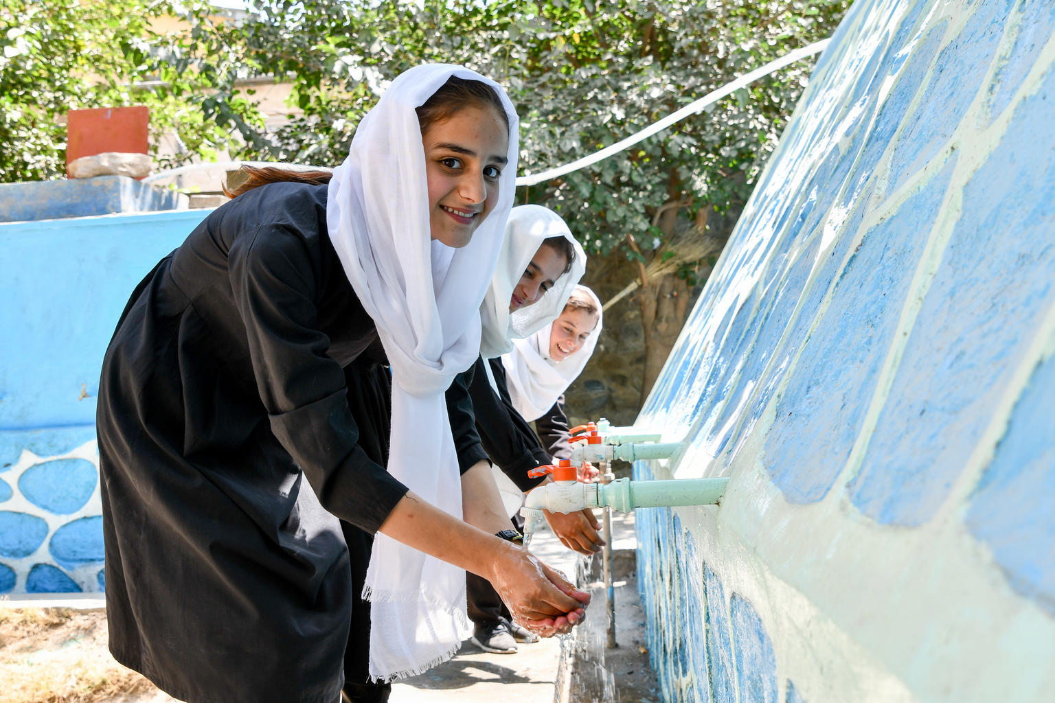 Girls washing their hands at the playground of the Haleema Sadia High School in Faizabad, Badakhshan a northeast province of Afghanistan. UNICEF has accelerated its work with the Ministry of Education to bring clean water, separate toilets for boys and gi