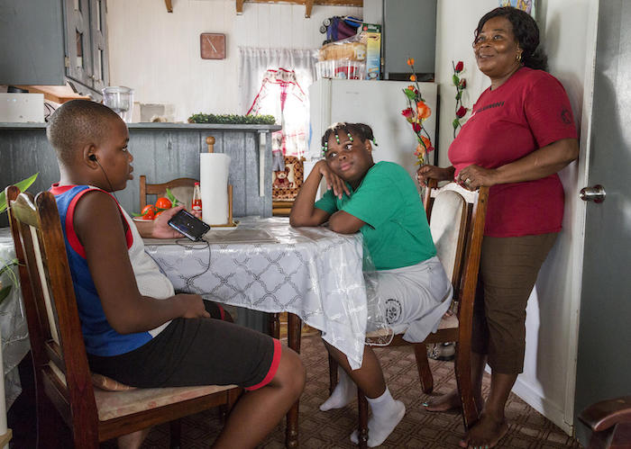 On November 7, 2019, Corine Gerald and her children Jerrene, 11, and James Jr., 13, at their temporary home on Antigua. The family was displaced from Barbuda by Hurricane Irma in 2017.