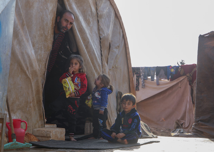 On November 16, 2019, a Syrian family displaced by violence shelters from the cold in an informal tented settlement in Killi, Idlib Governate, Syria, near the border with Turkey.