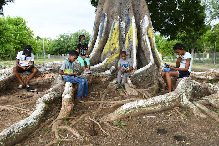 Primary school students remote learning in Westmoreland parish, Jamaica, during the coronavirus pandemic.