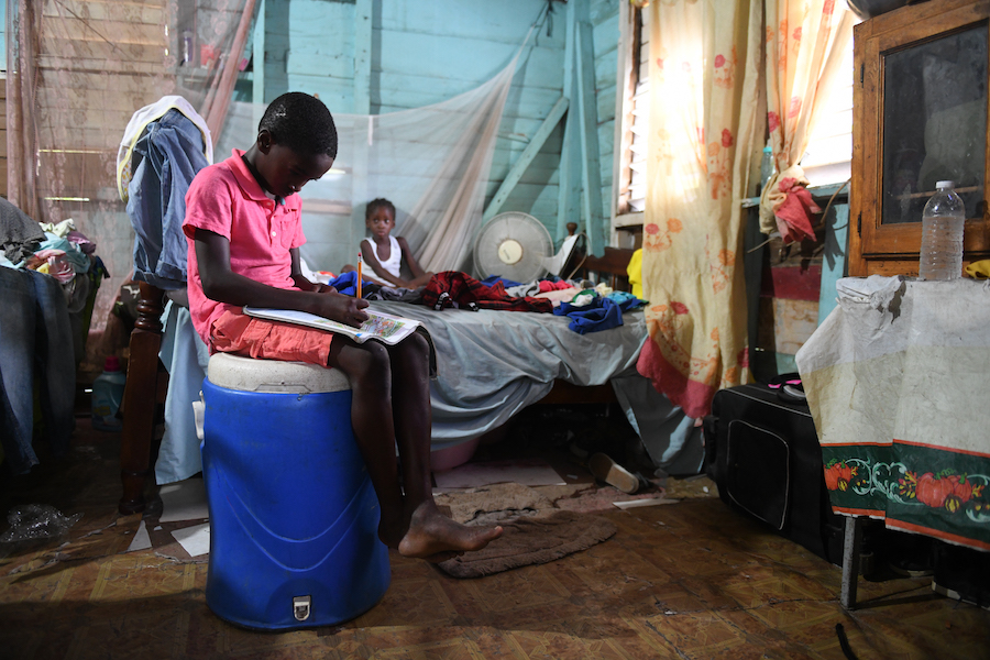 Joel tries to study at home in Jamaica while his school is closed due to the COVID-19 pandemic.