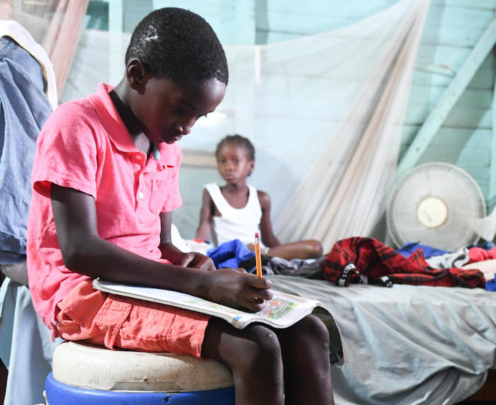 Joel, in Jamaica's Westmoreland parish, did schoolwork at home while his school was closed due to coronavirus concerns.