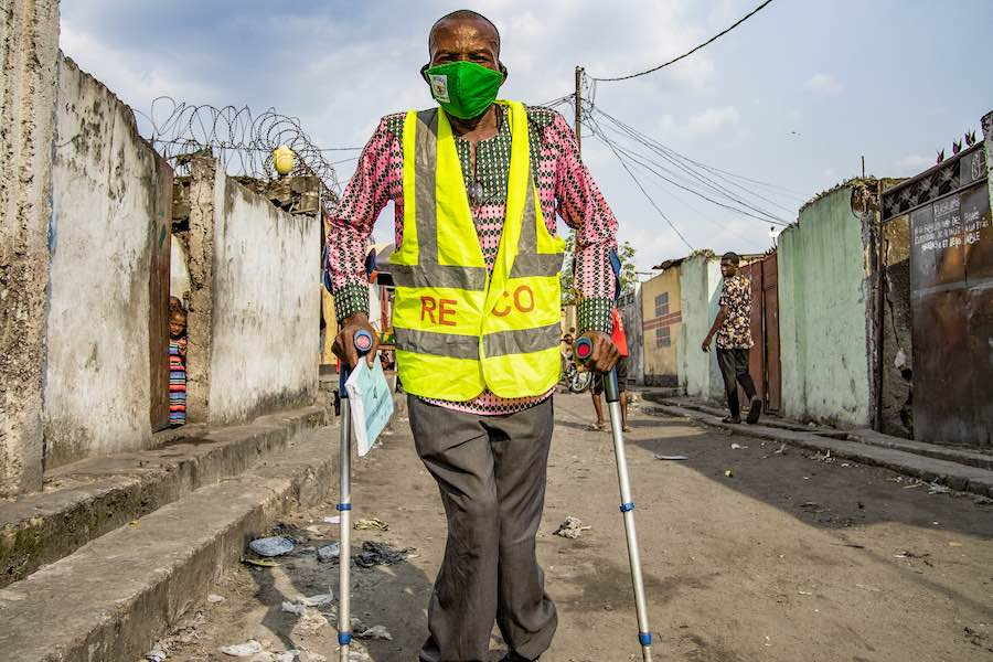 Richard Elaka, 60, is a polio survivor in Kinshasa, DR Congo. He was infected at the age of 7 and has been moving around on crutches ever since.