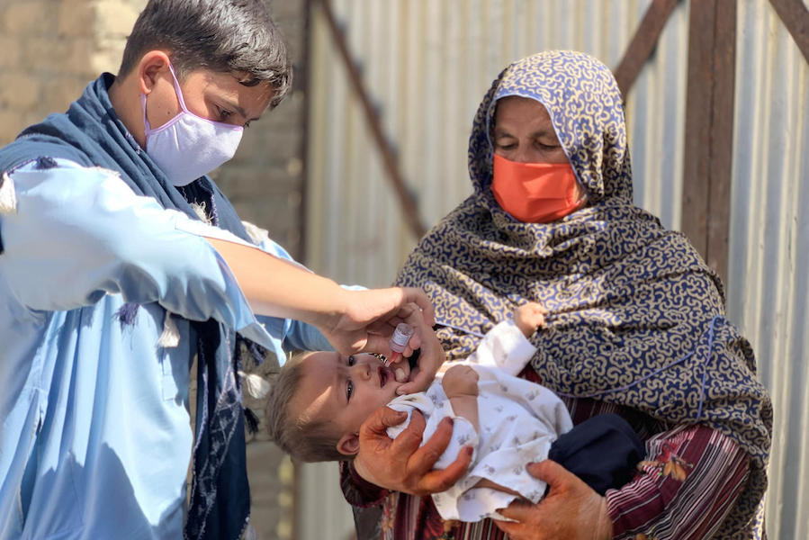 A 1-year old child receives the polio vaccine in the Spin Boldak district of Kandahar province during a UNICEF-supported vaccination campaign in September 2020 that targeted over 6 million children under age 5.