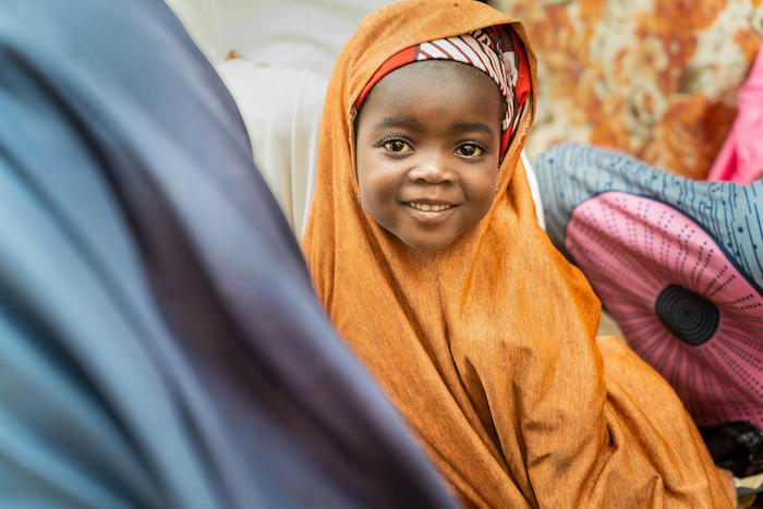 Umme, 4, photographed while attending a community meeting about healthy practices led by a UNICEF-trained volunteer — one of 20,000 volunteers who are the backbone of community outreach.
