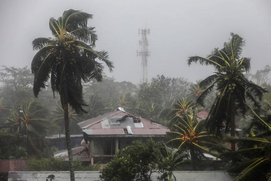View of a house with a damaged roof and palm trees blowing in the wind as Hurricane Eta makes landfall in Bilwi, Puerto Cabezas, Nicaragua, on November 3, 2020.