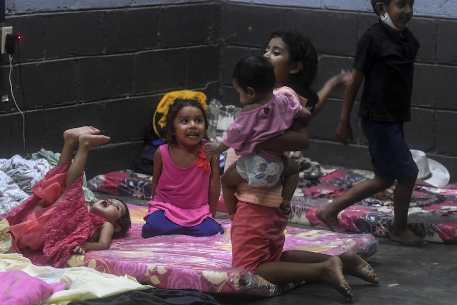 hildren play in a temporary shelter during heavy winds caused by Eta Hurricane at the Polideportivo in Tela, 300 km northern Tegucigalpa, on November 3, 2020.