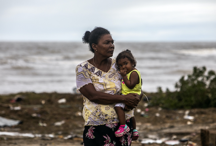 A mother and child survey the damage to their El Muelle neighborhood in Bilwi, Puerto Cabezas, Nicaragua, following Hurricane Eta on Nov. 5, 2020.