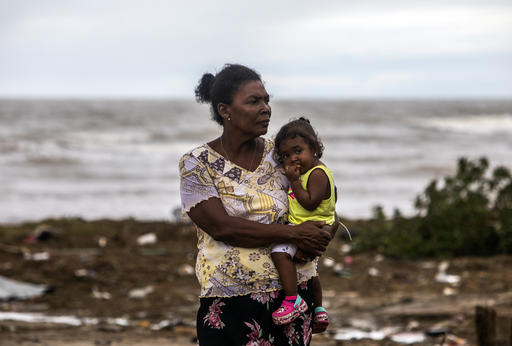 After Hurricane Eta hit Central America in 2020, many mothers and children were left with nothing. Here, one mom holds her baby as she surveys the rubble in their neighborhood in Puerto Cabezas, Nicaragua. The Inspired Gift collection offers essential sup