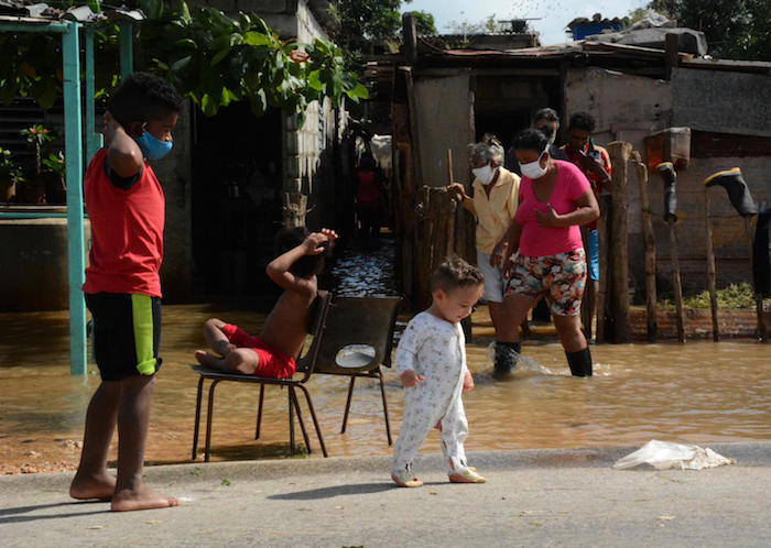 In Cuba on November 8, 2020, children play at Majagua municipality in the province of Ciego de Avila in the aftermath of Tropical Storm Eta.