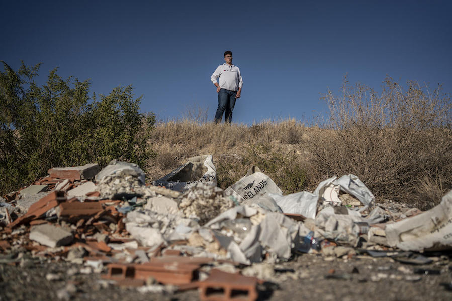 Environmental activist Juan, 17, regularly cleans up the garbage that accumulates in the fields surrounding his hometown, Almería, Spain.
