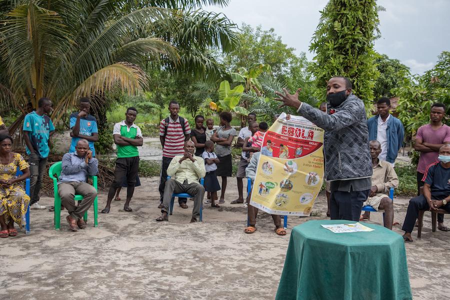 A community health worker raises awareness about Ebola and COVID-19 in Mama Balako health district, Mbandaka, DR Congo.
