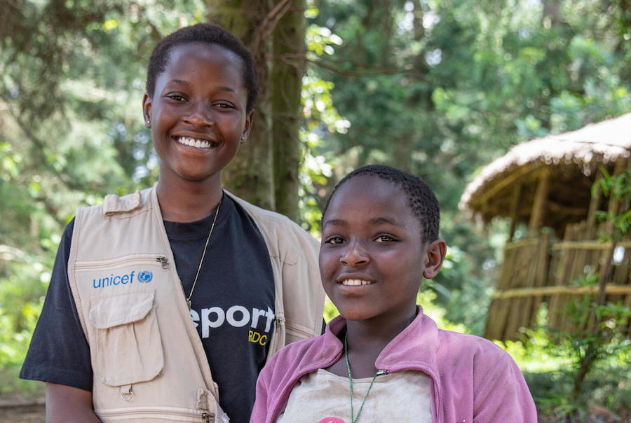 In Buhumba, DRC, UNICEF Child Reporter Ketsia, left, met with 12-year-old Prisca, who shared her concerns about her community's routine cutting of forest trees to make charcoal, a process that contributes to deforestation and global warming.