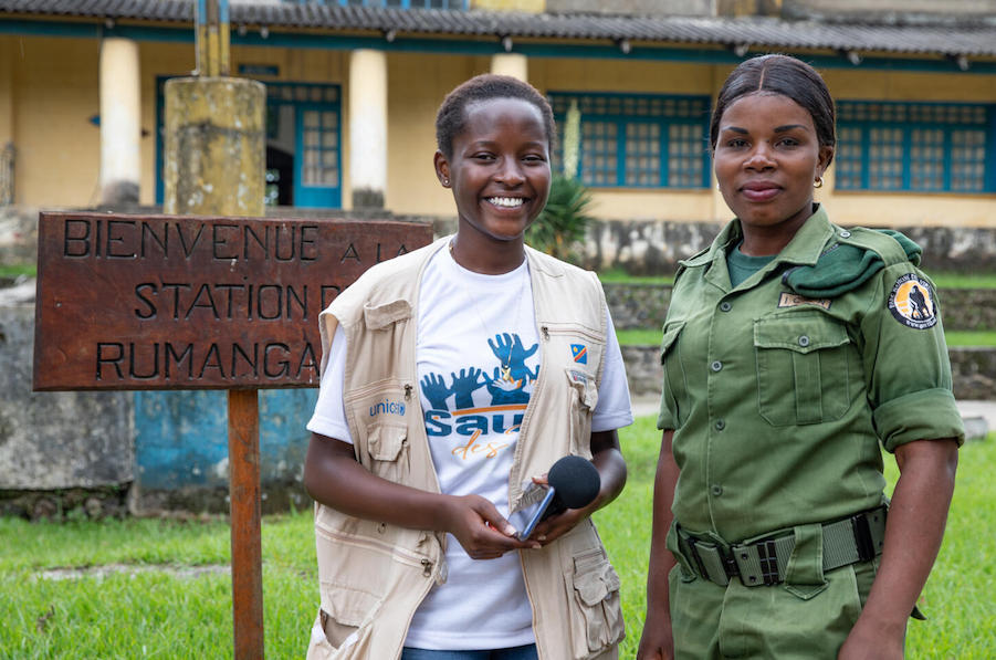 In Virunga National Park, DRC, 16-year-old UNICEF Child Reporter Ketsia, left, spoke with Aline, an eco-guard who monitors and protects the park.