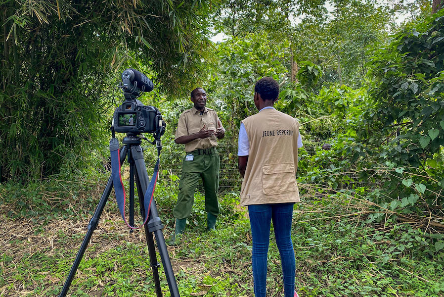 A UNICEF Child Reporter interviews an eco-guard at Virunga National Park in Democratic Republic of Congo.