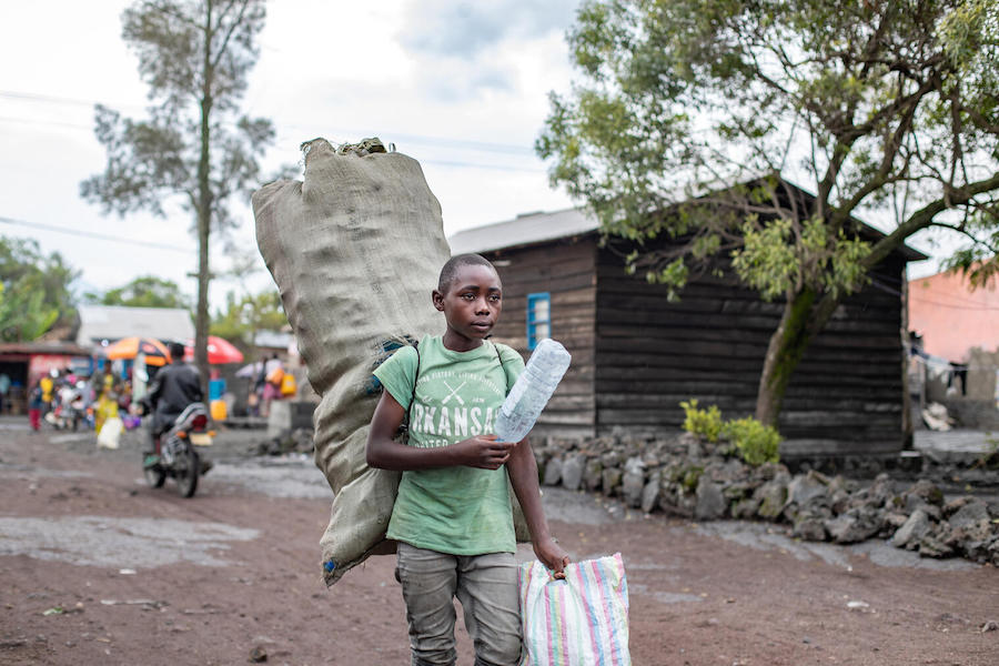 When he's not doing schoolwork, 15-year-old Destin collects and sells plastic bottles he finds in bins and rubbish heaps on the streets of Goma, the capital of North Kivu Province.