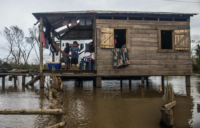Floodwaters surround a family's home in Bilwi, Nicaragua, in the wake of Hurricane Iota, Nov. 18, 2020.