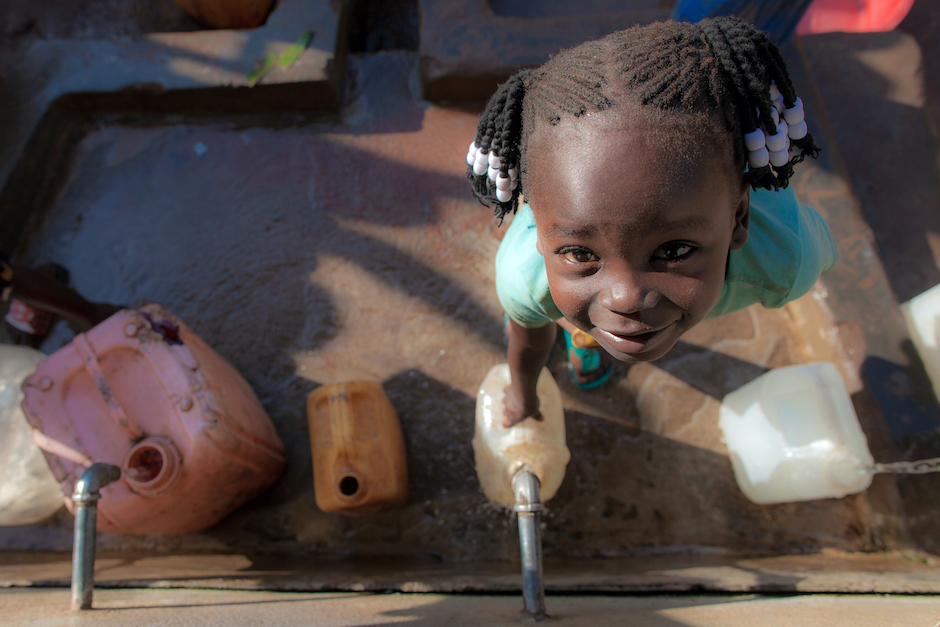 Queen, 5, collects water at a water point UNICEF helped improve in Yambio, South Sudan.