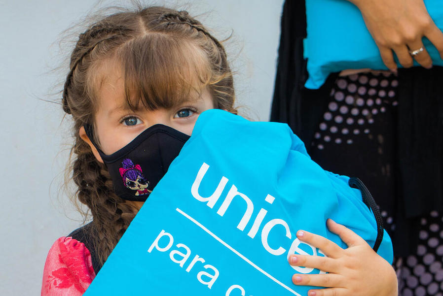 On October 26, 2020 in El Junco, Táchira State, Venezuela, Dianggelli holds a kit full of hygiene supplies distributed by UNICEF to help families protect themselves from the spread of the novel coronavirus.