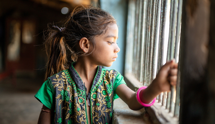Young child looking out a window
