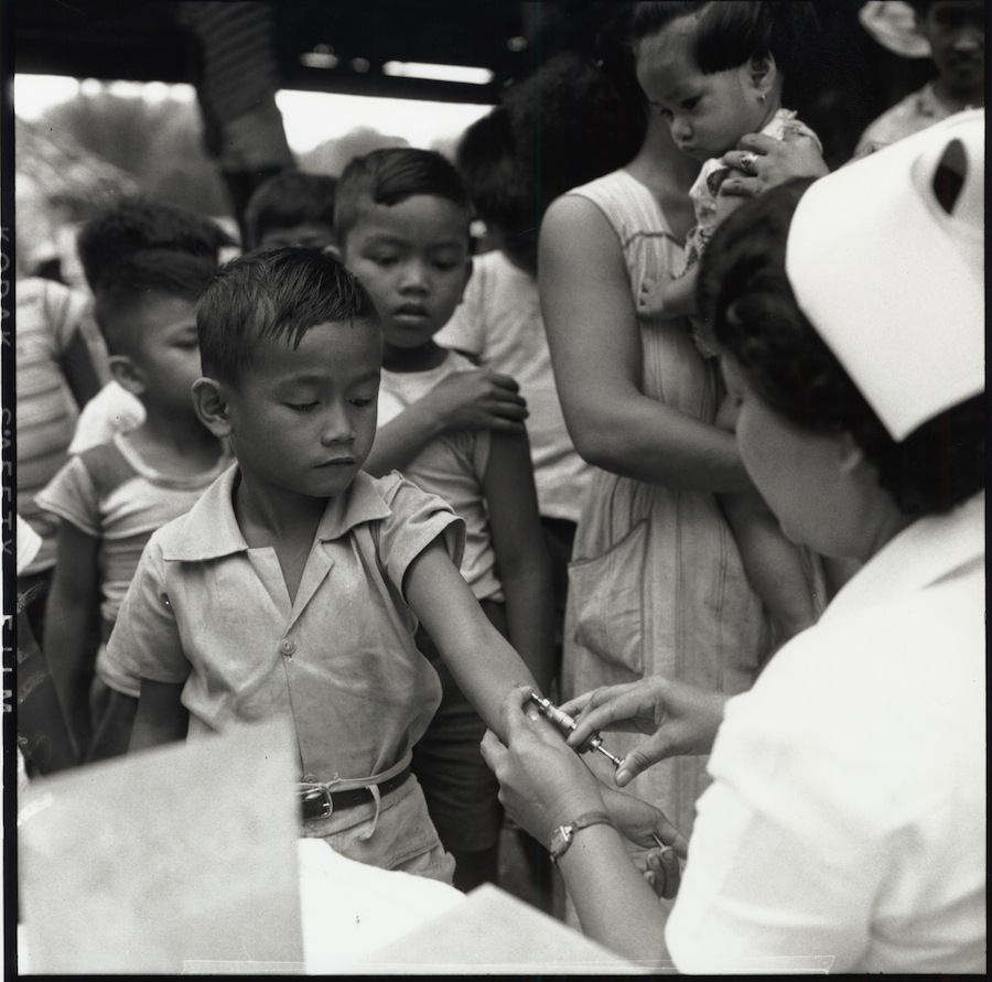 A boy receives the anti-tuberculosis vaccine during a UNICEF-supported campaign in The Philippines in 1952.