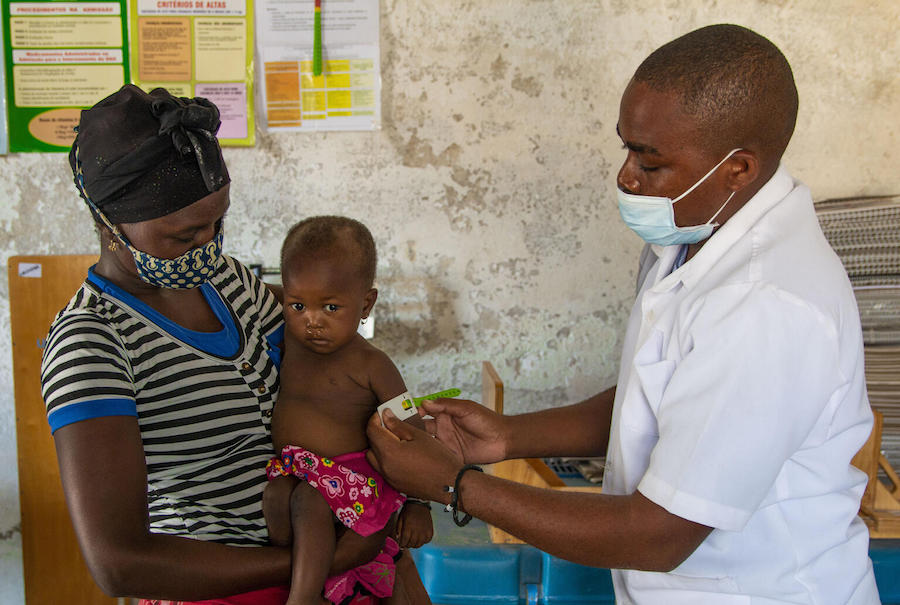 A UNICEF-trained community health worker screens 18-month-old Rosa for malnutrition in Cabo Delgado Province, Mozambique on December 3, 2020.