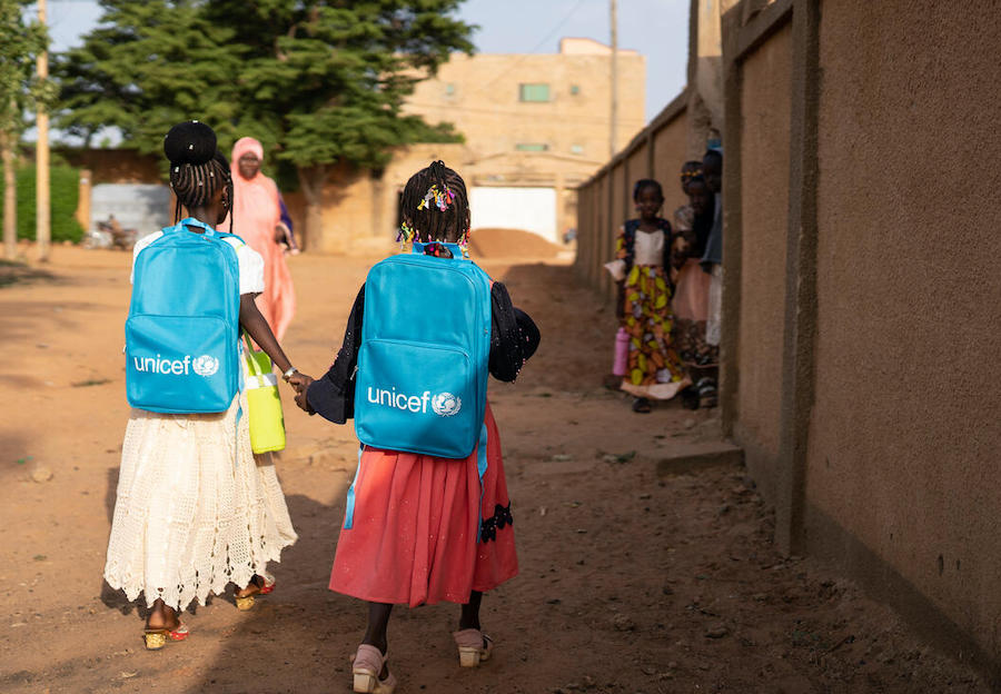 Two sisters in Niamey, Niger return to their school after a long absence due to a COVID-19 shutdown.