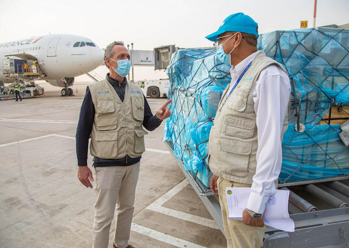 Unicef Representative in Mauritania Marc Lucet (left) with a UNICEF health consultant during delivery of 8,000 antigen-detecting tests to fight COVID-19 in January 2021.