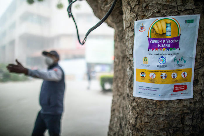 Information posted outside Pt. Madan Mohan Malviya Hospital in lead up to COVID-19 vaccination drive in New Delhi, India.