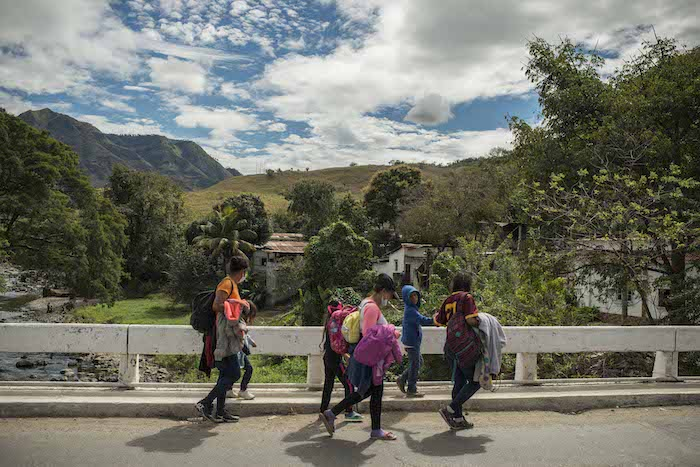 A family from Honduras makes their way into Guatemala, heading north.